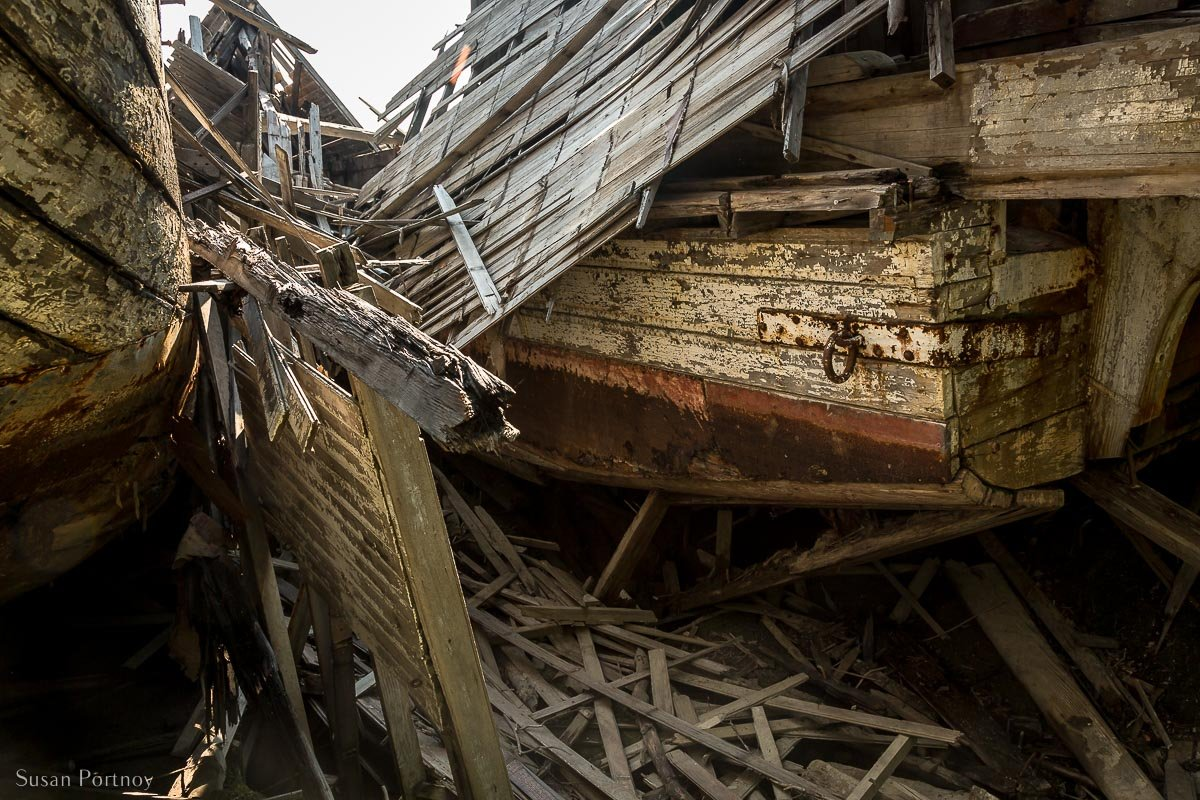 Pieces of multiple wrecks in the Sternwheeler Graveyard in Dawson City
