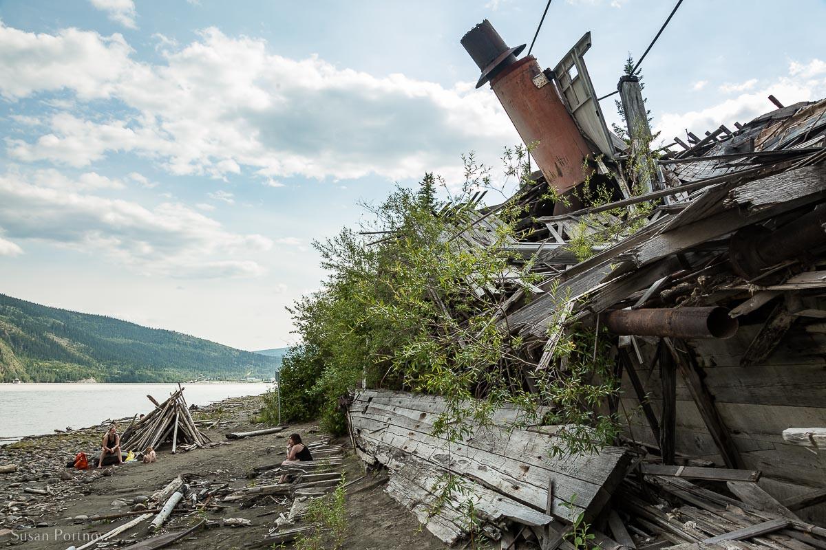 The wrecks of historic Sternwheeler boats left on the shore of the Yukon River - Sternwheeler Graveyard