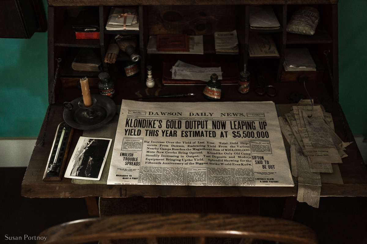 An old newspaper from the Gold Rush Era on a desk inside the Jack London Museum and Cabin