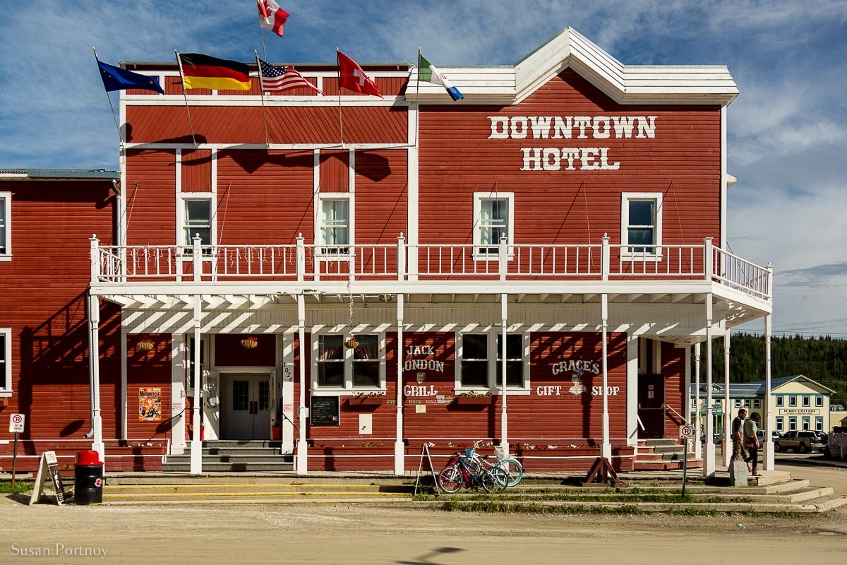 The red front facade of the Downtown Hotel in Dawson City, Yukon