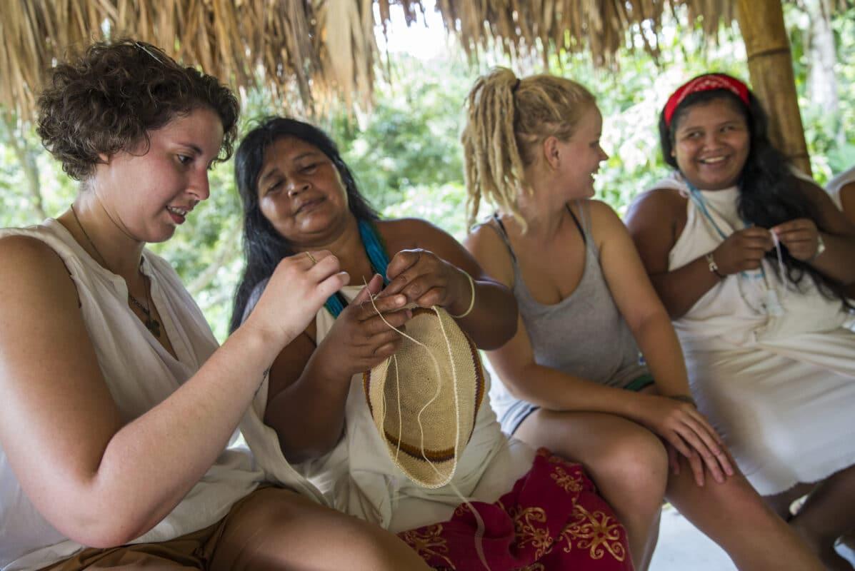 Women learning from Wiwa Women in Colombia