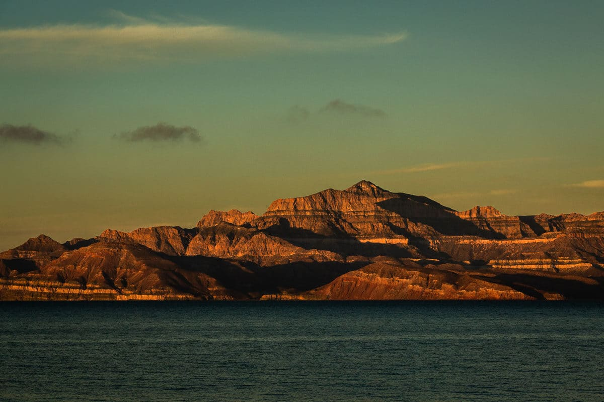 View from the water of a ridge of mountains at sunrise in the Sea of Cortez