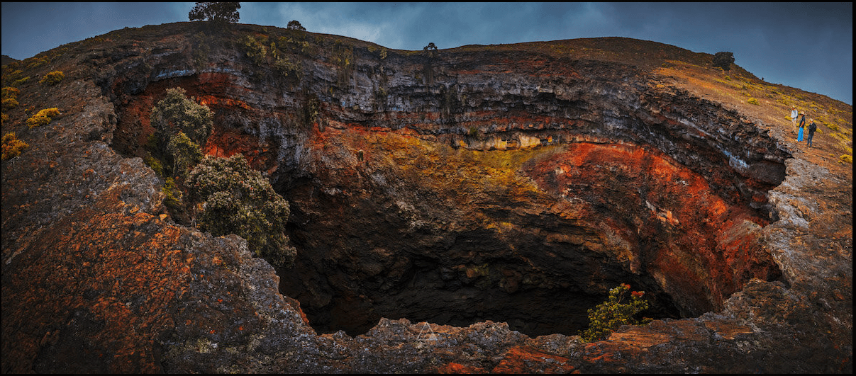 Looking into the multi-colored crater of the Hualalai Volcano. One of the cool experiences in Hawaii led by a local