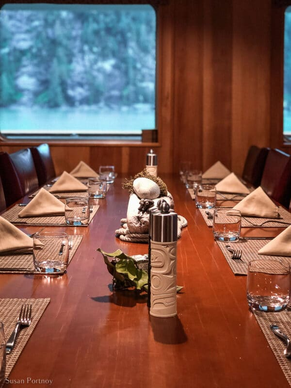 An elegantly set table aboard the Cascadia in the Great Bear Rainforest