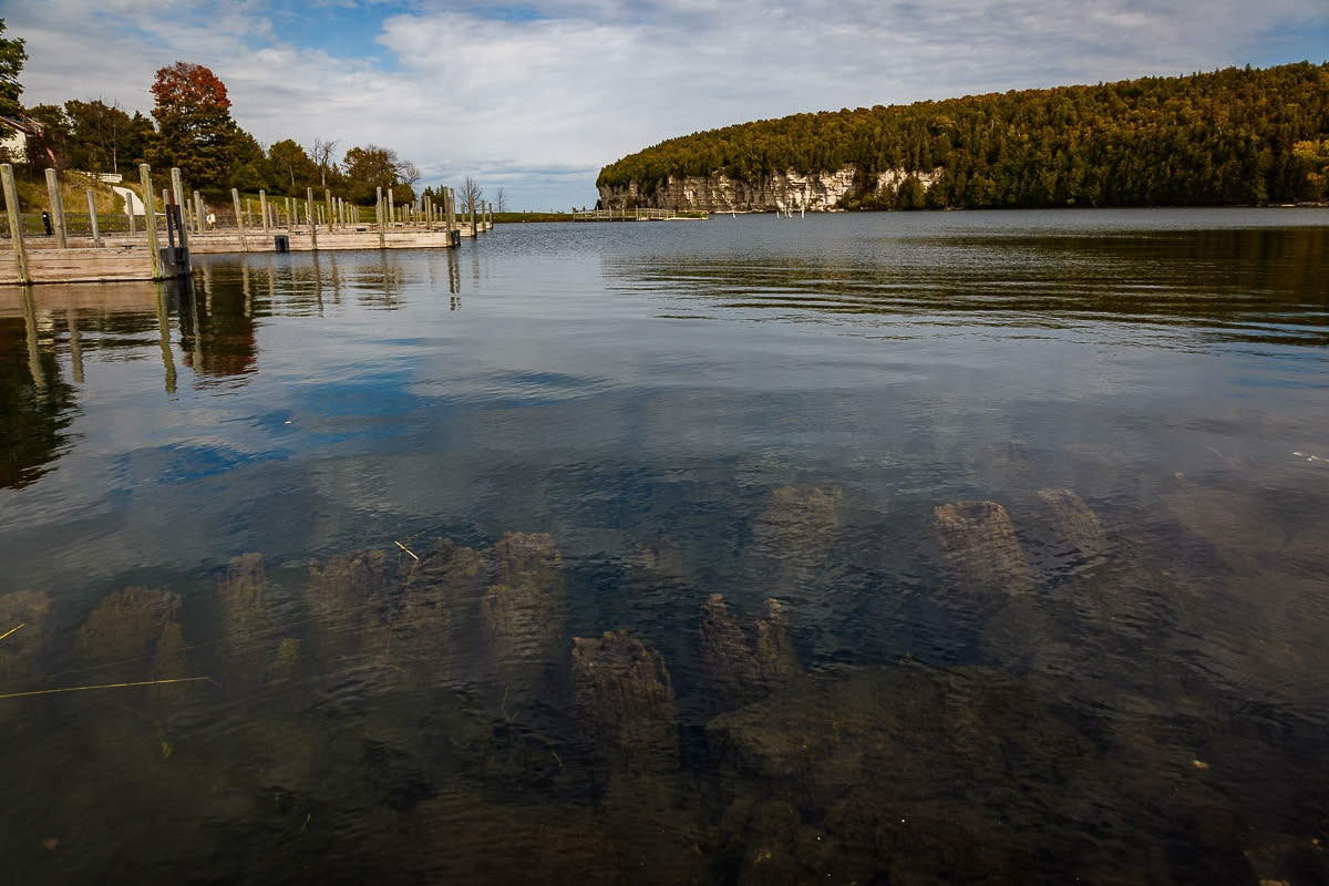 Old pilings underwater in Snail Shell harbor at Fayette State Park