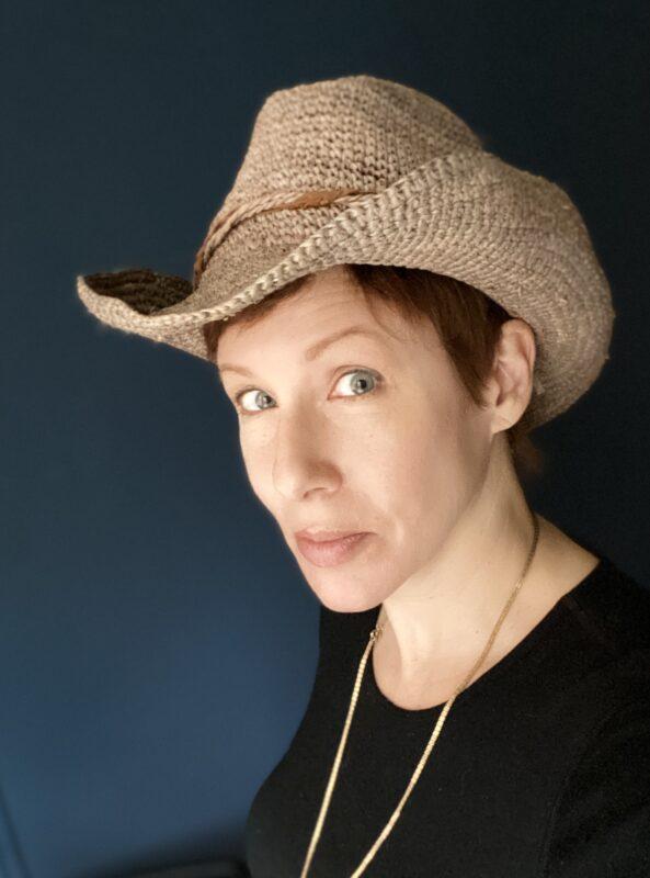 Susan Portnoy, The Insatiable Traveler, wearing the Hannah Cowboy Hat by Wallaroo