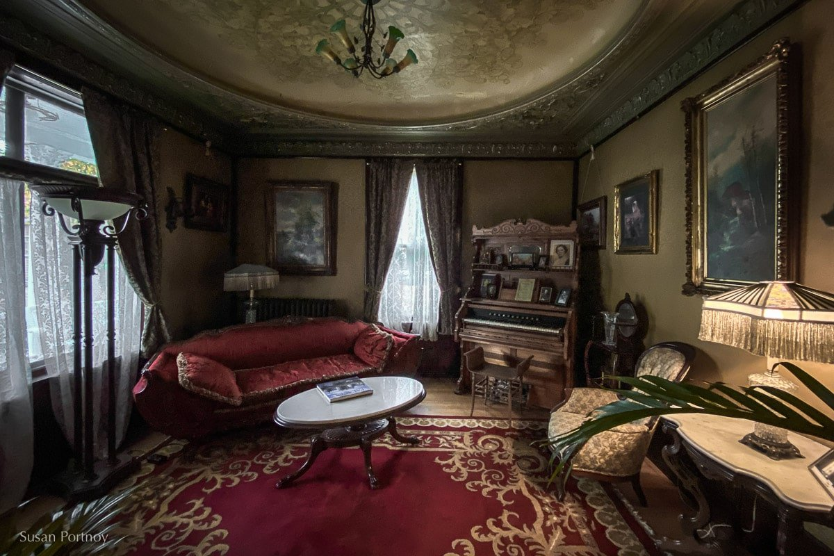 The parlor / music room at the Laurium Manor Inn