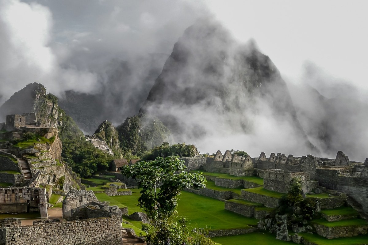A stunning view of the mountains of Machu Picchu ringed with morning sunrise fog