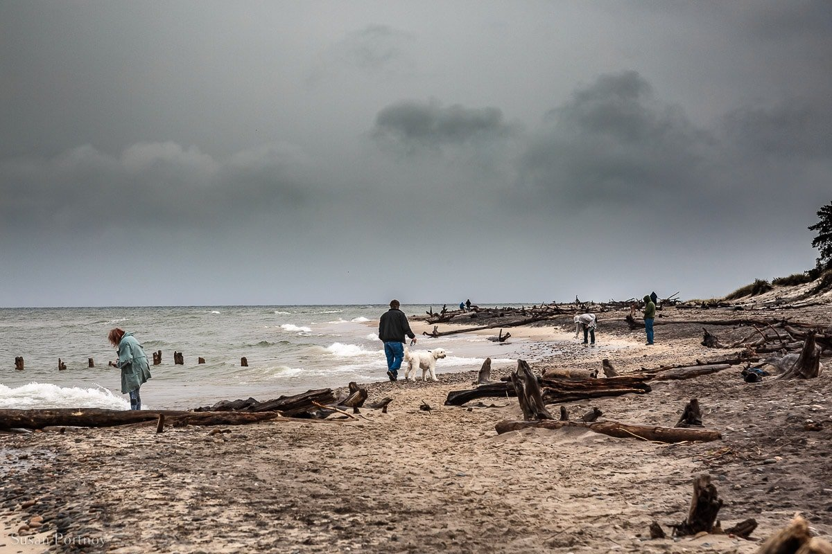 Visitors walk along the shore at Whitefish Point, in the upper Peninsula