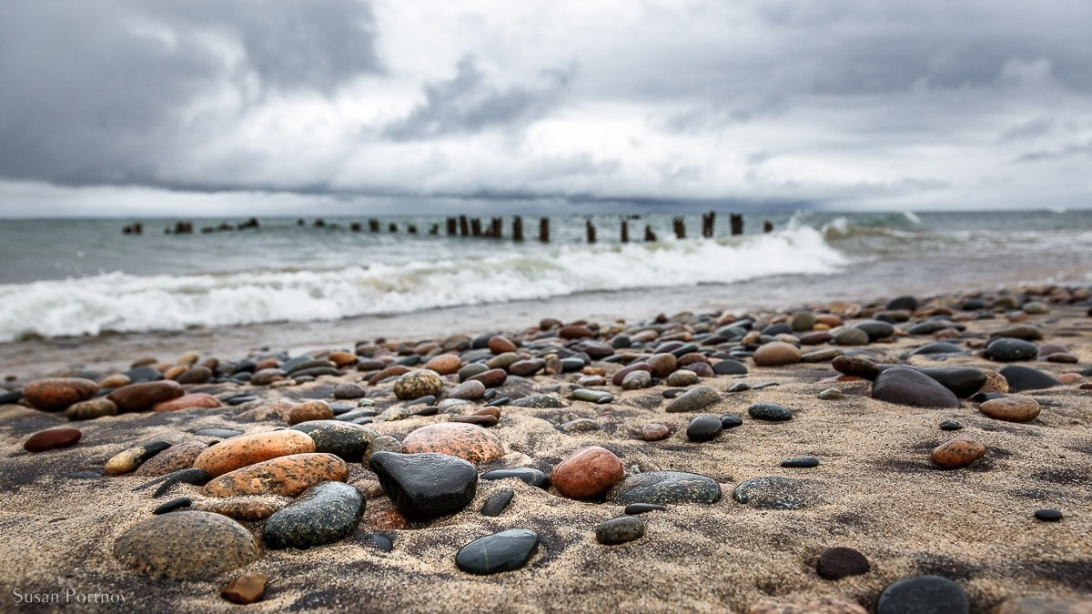 Closeup of stones and the shore of Whitefish Point during a storm