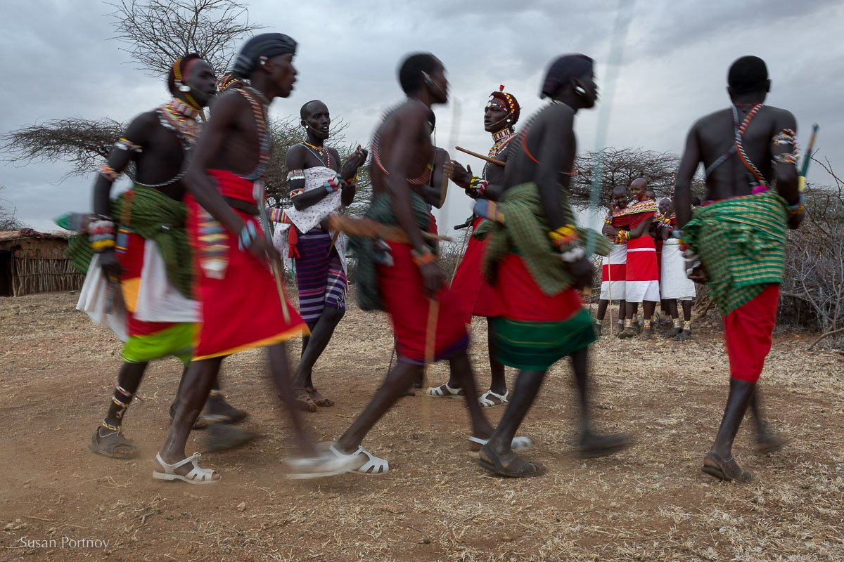 Samburu warriors (moran) dance for young women in northern Kenya.