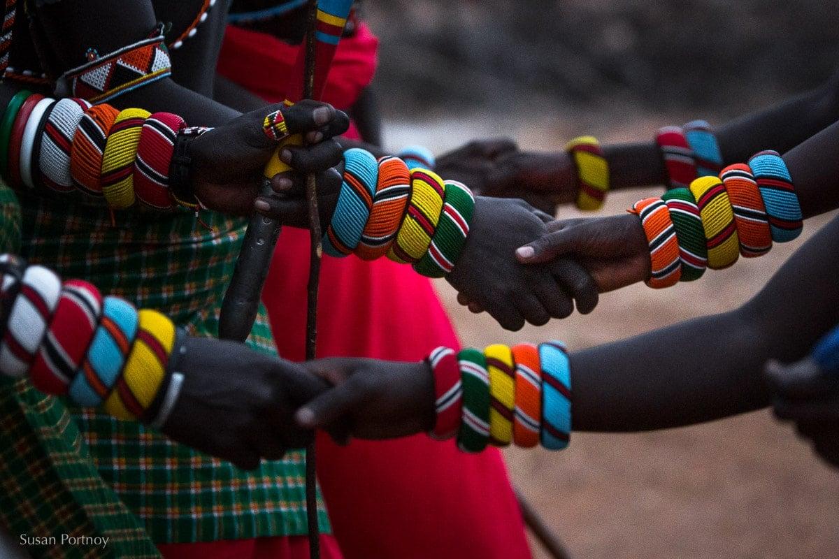 samburu-men-and-women-hold hands during a dance in Northern Kenya