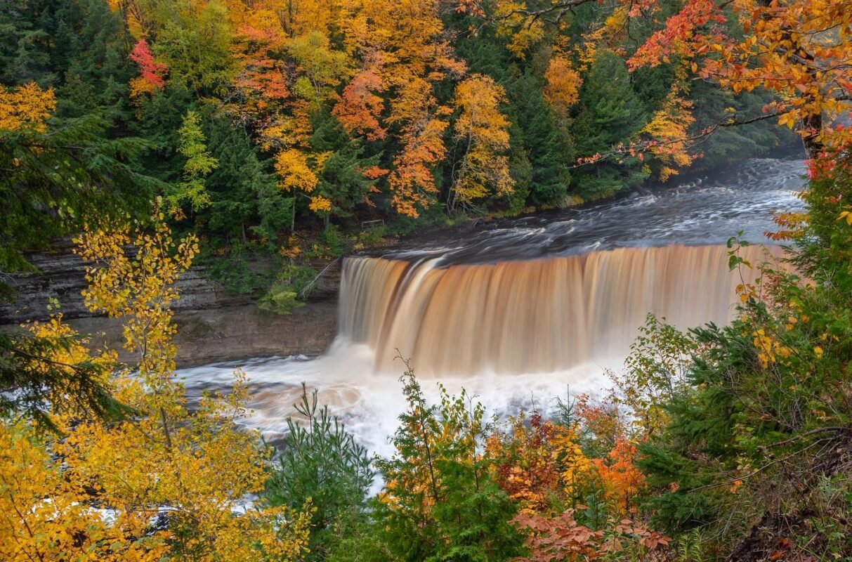 Upper Tahquamenon Falls surrounded by the Upper peninsula's fall colors. A very popular attraction on a road trip.