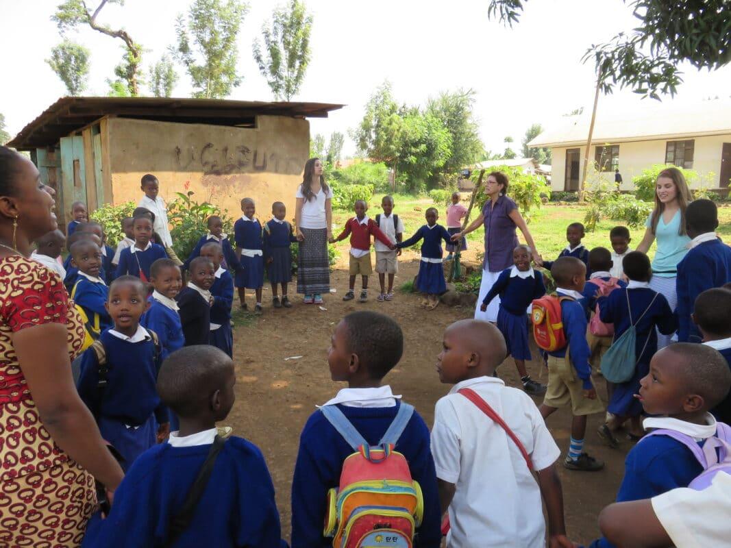 Discover Corps traveler volunteers work with children in Tanzania