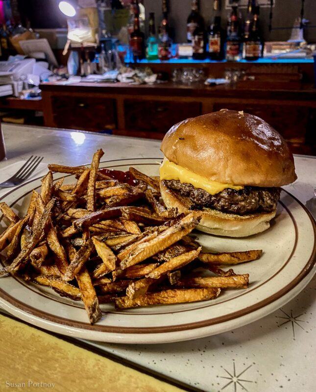 A hamburger and fries on a plate in the Trout Lake Tavern