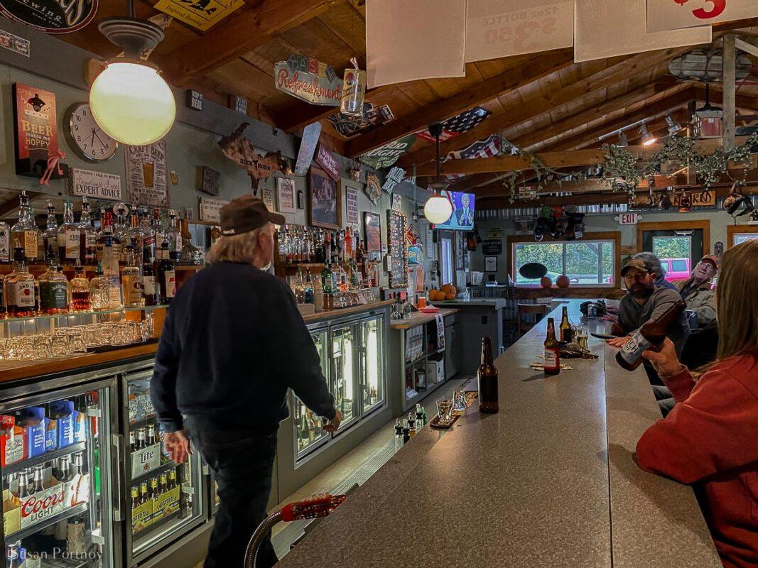 Steve the bartender, walking behind the bar at Buckhorns in Trout Lake, MI