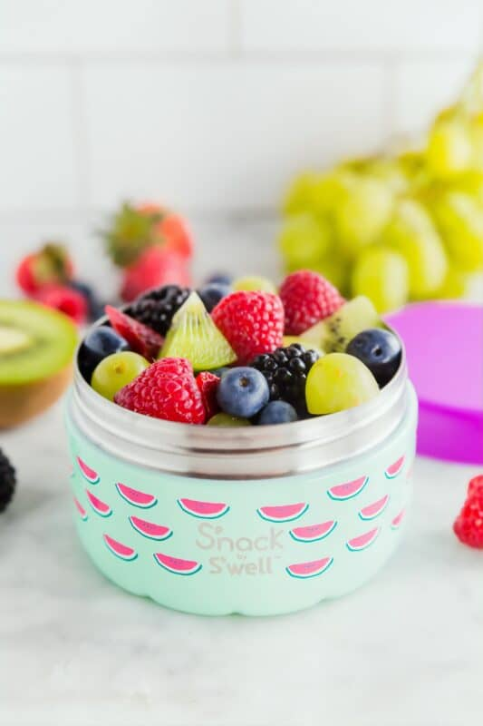 Sliced fruit in a travel container